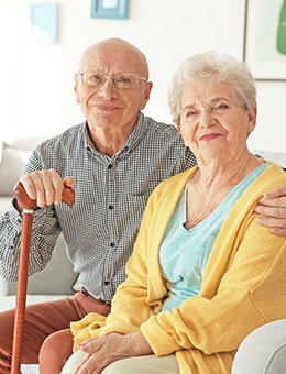 Elderly couple sitting on a couch